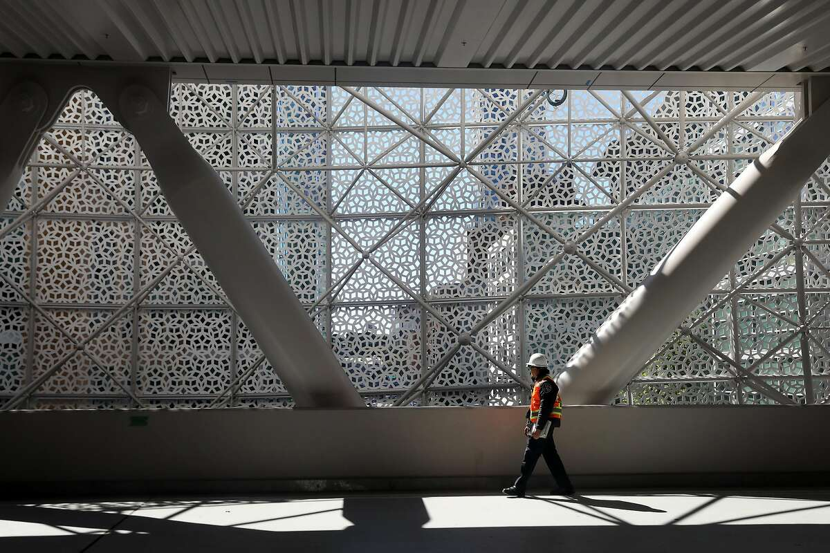 Security personnel walks along the roadway on the third floor of the Salesforce Transit Center on Monday, July 9, 2018 in San Francisco, Calif.