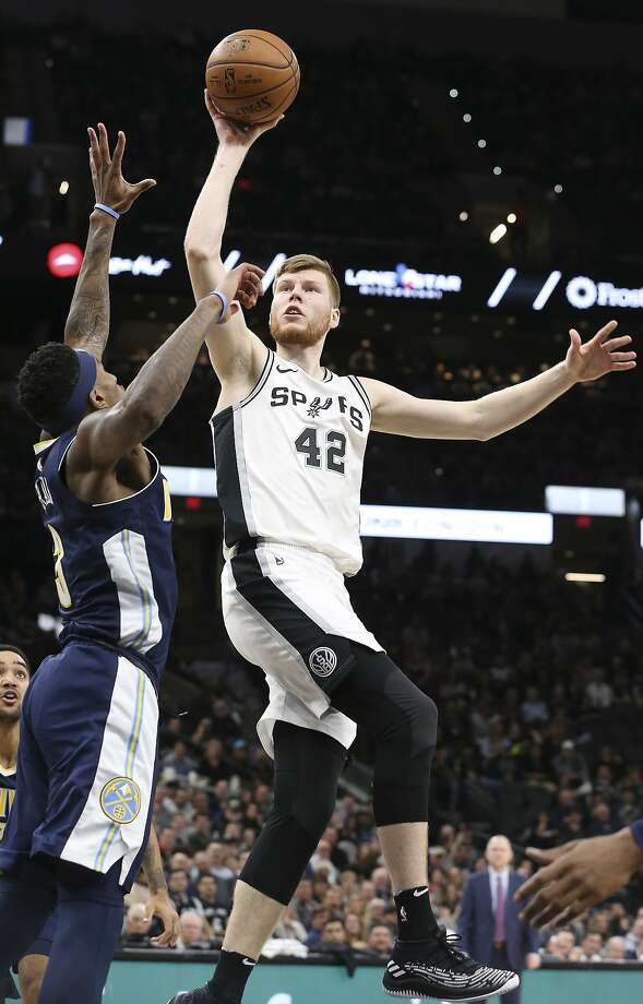 Davis Bertans puts up a runner against Torrey Craig as the Spurs play Denver at the AT&T Center on January 30, 2018. Photo: Tom Reel, San Antonio Express-News