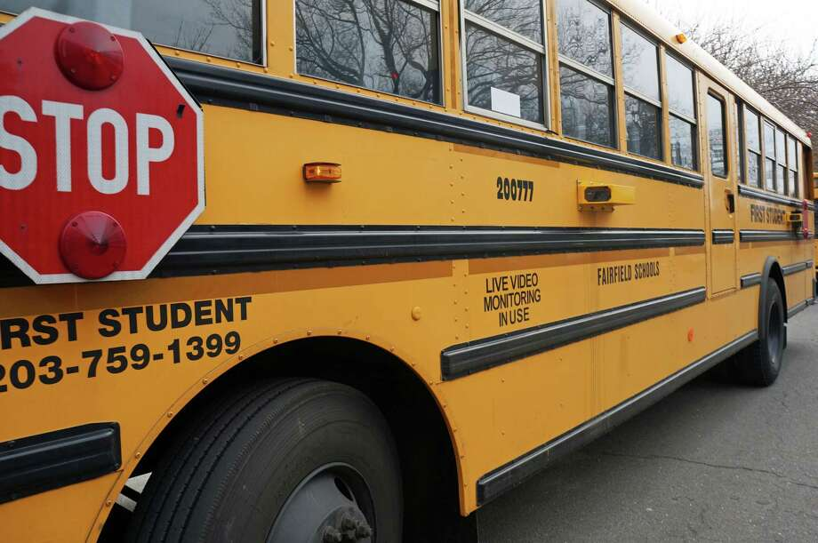 School buses, such as this one in Fairfield, Connecticut, were outfitted with cameras in local school districts to record motorists who don't stop for a stopped school bus as required by law. Photo: Genevieve Reilly /Genevieve Reilly / Fairfield Citizen