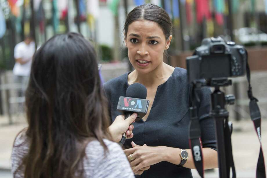 Alexandria Ocasio-Cortez, a winner of a Democratic Congressional primary in New York speaks to a reporter, June 27, 2018, in New York. The 28-year-old political newcomer upset U.S. Rep. Joe Crowley in New York's Democrat primary, a sign not so much of the baton passing to a Latina Democrat but being wrested from a white Democrat. Photo: Mary Altaffer /Associated Press / Copyright 2018 The Associated Press. All rights reserved.