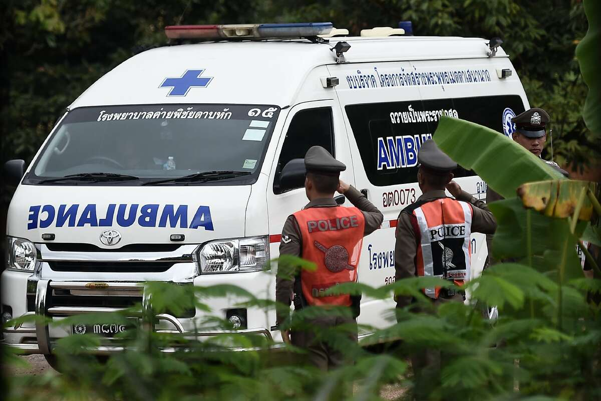 An ambulance exits from the Tham Luang cave area as operations continue for the 8 boys and their coach trapped at the cave in Khun Nam Nang Non Forest Park in the Mae Sai district of Chiang Rai province on July 9, 2018. - Four boys among the group of 13 trapped in a flooded Thai cave for more than a fortnight were rescued on July 8 after surviving a treacherous escape, raising hopes elite divers would also save the others soon.