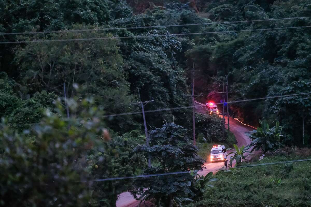 Two ambulances carrying the sixth and seventh boys out of Tham Luang Nang Non cave site to a hospital in Chiang Rai on July 9, 2018 in Chiang Rai, Thailand. Divers began an effort to free the 12 boys and their soccer coach on Sunday morning after they were found alive in the cave in northern Thailand.