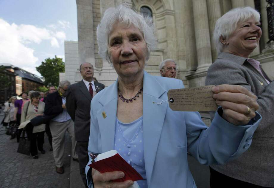 A former evacuee, shows a handwritten label with information about her name, her hometown and the towns she was evacuated to, during World War II, prior to a church service at St. Paul's Cathedral, commemorating the 70th anniversary of the first children to be evacuated, in central London, Tuesday Sept. 1, 2009. Organized by the Evacuation Reunion Association, hundreds of people gathered to mark the 70th anniversary of the evacuation of three million children in Britain ahead of the Second World War. Photo: LEFTERIS PITARAKIS, STF / AP / AP