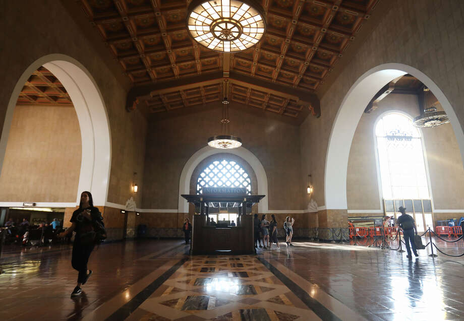People walk in Union Station, a public transit hub, on March 28, 2018 in Los Angeles, California.  Photo: (Photo By Mario Tama/Getty Images)