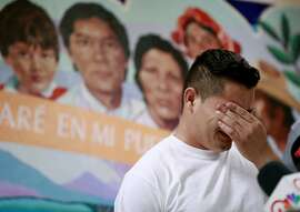 FILE - In this June 25, 2018 file photo, Christian, from Honduras, recounts his separation from his child at the border during a news conference at the Annunciation House,in El Paso, Texas.  A judge has put off at least until Monday, July 9,  a ruling on a Trump administration request for more time to reunite more than 100 children under 5 who were separated from their parents after crossing the border. U.S. District Judge Dana Sabraw ordered the Justice Department to share a list of the 101 children by Saturday afternoon with the American Civil Liberties Union, which successfully sued the administration to force the young children and families to be reunited by Tuesday. (AP Photo/Matt York, File)