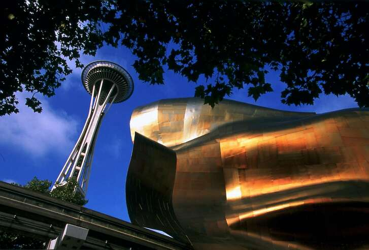 The EMP Museum and the Space Needle share space at the Seattle Center Grounds.