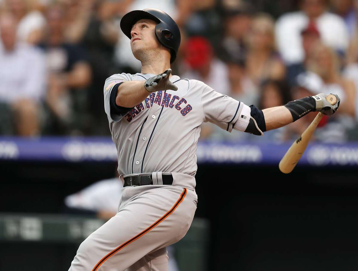 San Francisco Giants' Buster Posey flies out on a pitch from Colorado Rockies' Tyler Anderson during the fourth inning of a baseball game Wednesday, July 4, 2018, in Denver. Posey will be missing out on this year's All-Star game in order to rest an injury.