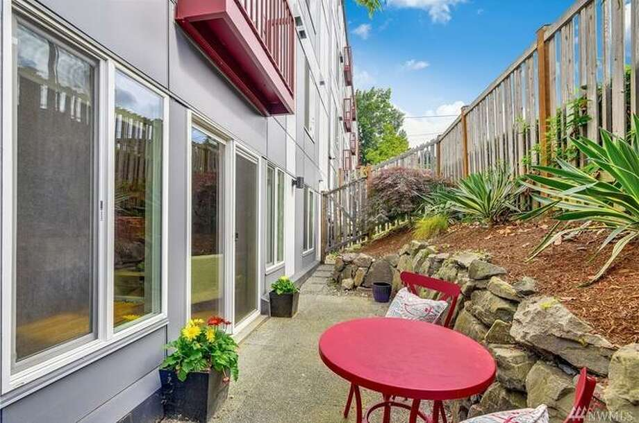 3661 Phinney Ave N #102, Seattle, WA 98103, listed for $399,950. See the full listing below. Photo: Windermere Real Estate/HLC