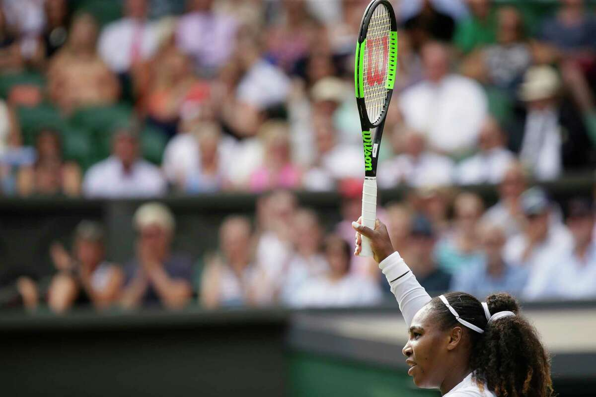 Serena Williams of the United States returns the ball to Russia's Evgeniya Rodina during their women's singles match, on day seven of the Wimbledon Tennis Championships, in London, Monday July 9, 2018. (AP Photo/Tim Ireland)