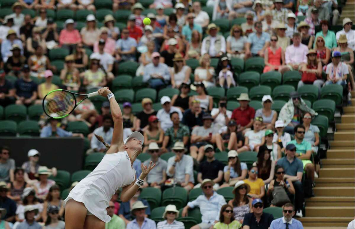 Kiki Bertens of the Netherlands serves to Karolina Pliskova of the Czech Republic during their women's singles match on the seventh day at the Wimbledon Tennis Championships in London, Monday July 9, 2018. (AP Photo/Ben Curtis)