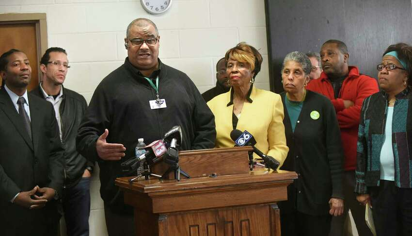 Derek Johnson, home school coordinator for the Albany School District, center, speaks during a news conference on Wednesday, Jan. 20, 2016, at Union Missionary Baptist Church in Albany, N.Y. Community Leaders, local organizations and parents called on the Albany City School District Board of Education to renew its contract with Superintendent Marguerite Vanden Wyngaard, which is set to expire in June. (Cindy Schultz / Times Union)