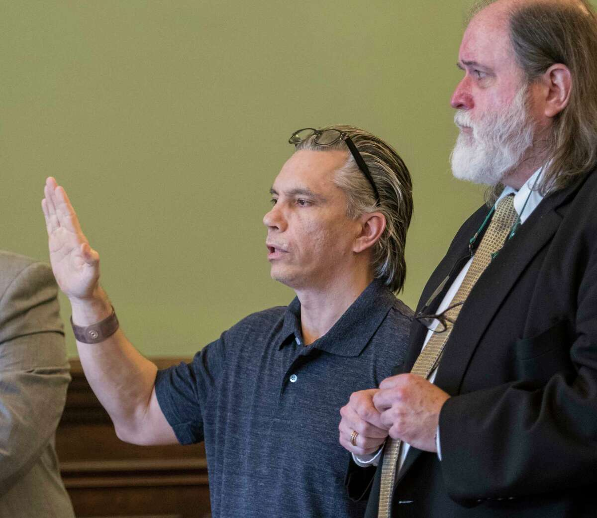 Defendant Richard J. Wright is sworn in during his retrial on his previous conviction for murder and arson which he has spent 32 years in jail Monday July 9, 2018 at the Rensselaer County Courthouse in Troy, N.Y. (Skip Dickstein/Times Union)