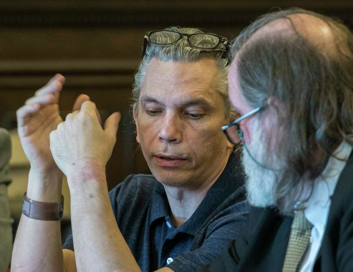 Defendant Richard J. Wright, left speaks with his attorney Michael McDermott during his retrial on his previous conviction for murder and arson which he has spent 32 years in jail Monday July 9, 2018 at the Rensselaer County Courthouse in Troy, N.Y. (Skip Dickstein/Times Union)