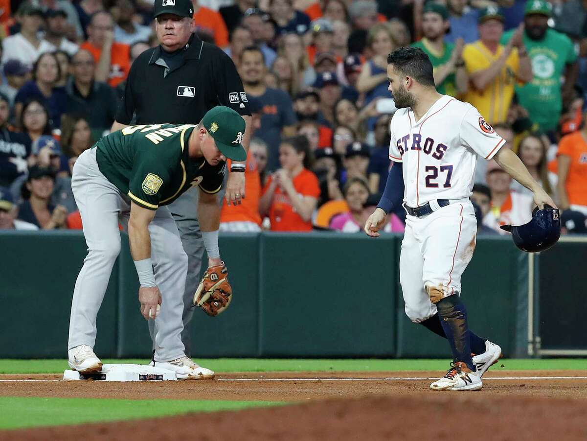 Houston Astros Jose Altuve (27) reacts after getting tagged out at third base by Oakland Athletics Matt Chapman during the fourth inning of an MLB game at Minute Maid Park, Monday, July 9, 2018, in Houston.