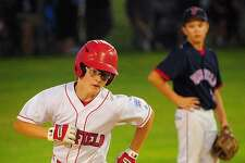 Fairfield American's Pierce Cowles rounds second after hitting a three-run homer in the 4th inning of Monday's 8-1 win over Fairfield National at Unity Park in Trumbull.