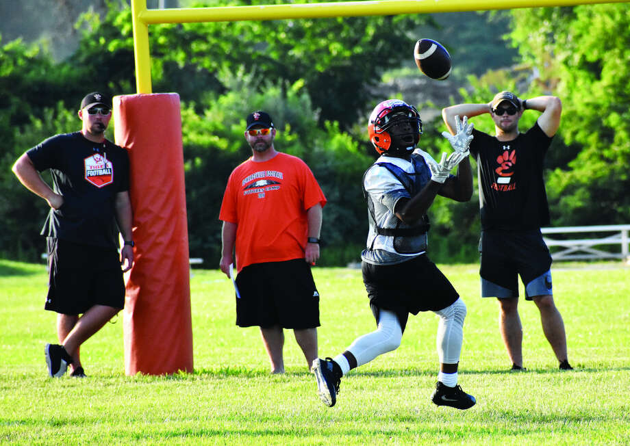 Edwardsville running back Antonio Thipgen Jr. hauls in a touchdown pass with the EHS defensive coaches watching from beyond the end zone during the first game against Gateway STEM at EHS.