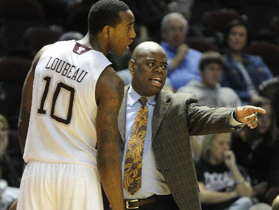 Texas A&M assistant head coach Glynn Cyprien talks with player David Loubeau (10) during the first half of an NCAA college exhibition basketball game against Dallas Baptist on Thursday, Nov. 3, 2011, in College Station. (AP Photo/Pat Sullivan)