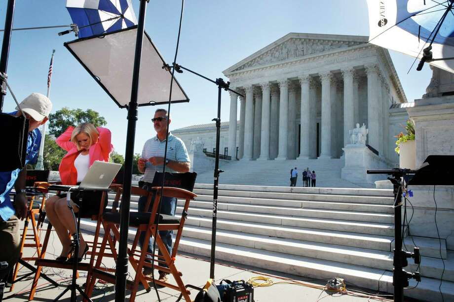 Television crews set up in front of the Supreme Court, Monday, July 9, 2018, in Washington. President Donald Trump is expected to announce his choice on a replacement for retiring Supreme Court Justice Anthony Kennedy Monday evening. (AP Photo/Jacquelyn Martin) Photo: Jacquelyn Martin / Copyright 2018 The Associated Press. All rights reserved.