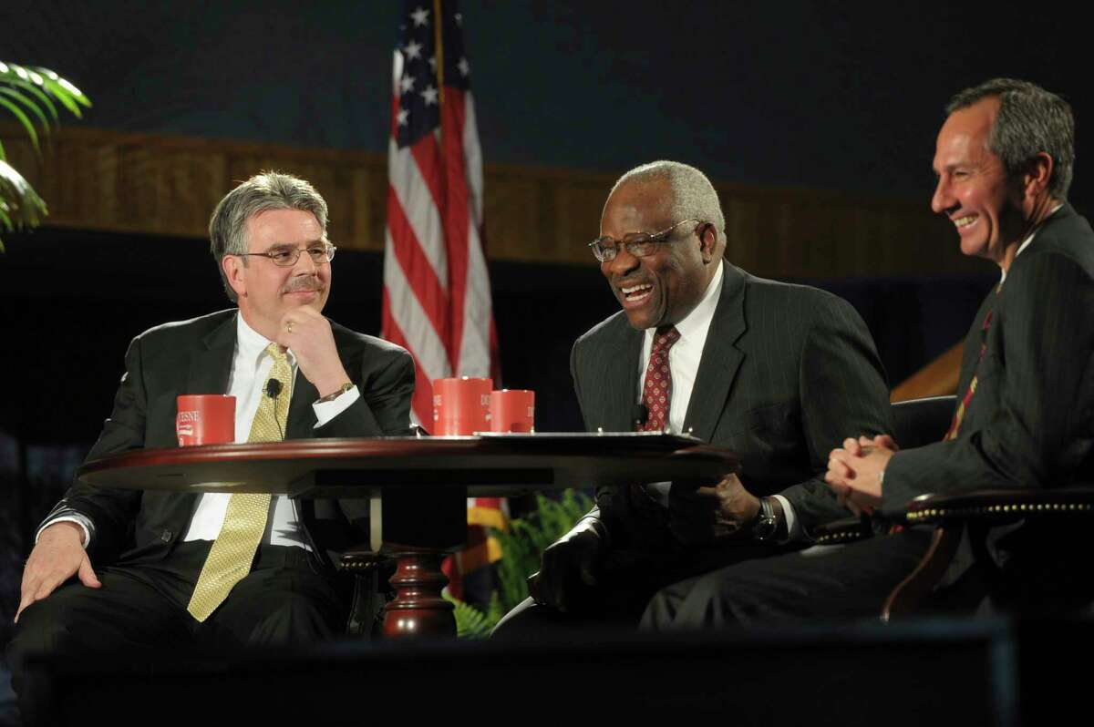 In a Tuesday, April 9, 2013 photo, U.S. Supreme Court Justice Clarence Thomas, center, shares a laugh with Duquesne University School of Law Dean Ken Gormley, left, and U.S. Court of Appeals Judge Thomas M. Hardiman, at the university in Pittsburgh. Judge Hardiman is on the short list of nominees for President Donald Trump's nomination to the U.S. Supreme Court Monday, July 9, 2018. (Rebecca Droke/Pittsburgh Post-Gazette via AP)