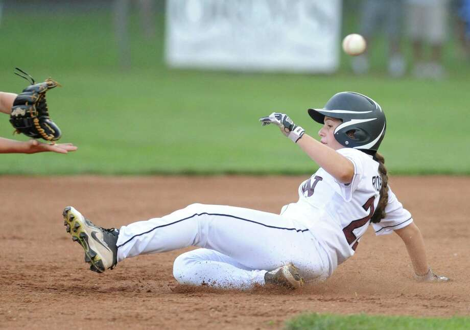 Stamford National's Cassie Robotti slides safely into second base in the District I Little League baseball playoff game between Stamford National and Weston at Bill Terry Field in Wilton, Conn. Monday, July 9, 2018. Photo: Tyler Sizemore / Hearst Connecticut Media / Greenwich Time