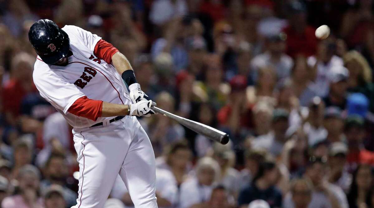Boston Red Sox's J.D. Martinez drives a three run home run out during the eighth inning of a baseball game against the Texas Rangers at Fenway Park in Boston, Monday, July 9, 2018. (AP Photo/Charles Krupa)