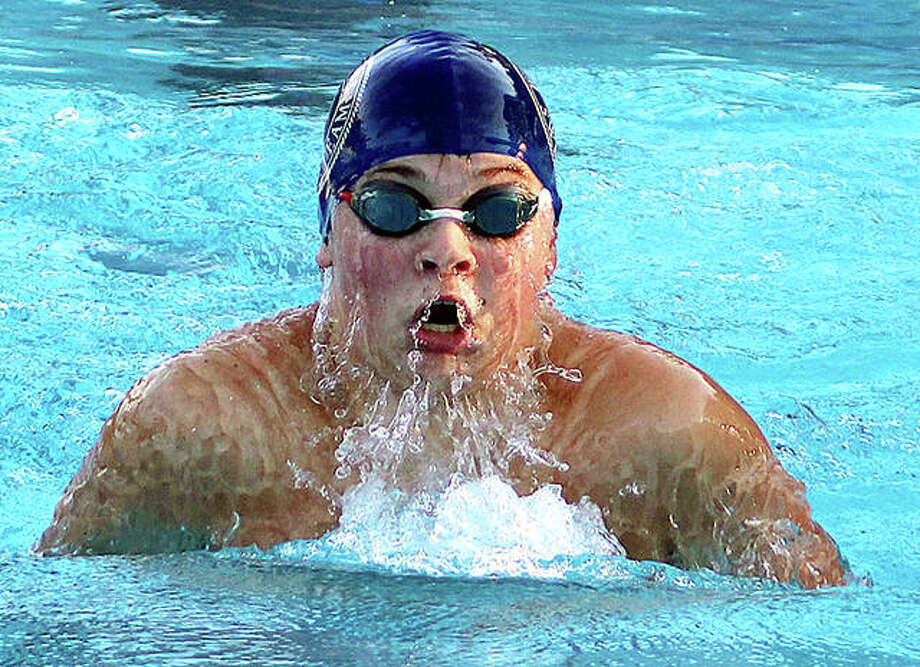 Cohen Osborn of Water Works competes in the breaststroke portion of the 13-14 boys 200-yard medley relay Monday night at Summers Port pool in Godfrey. Photo:     Pete Hayes | The Telegraph