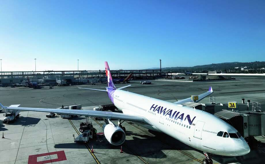A Hawaiian Airlines A330 loading up for the 5 hour flight to Honolulu  Photo: Chris McGinnis