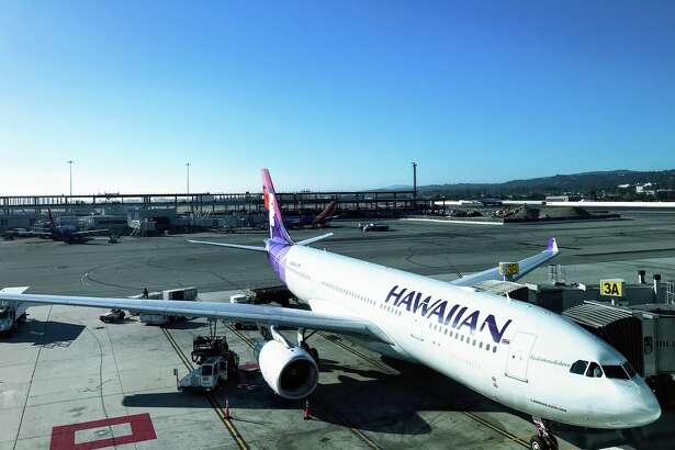 A Hawaiian Airlines A330 loading up for the 5 hour flight to Honolulu