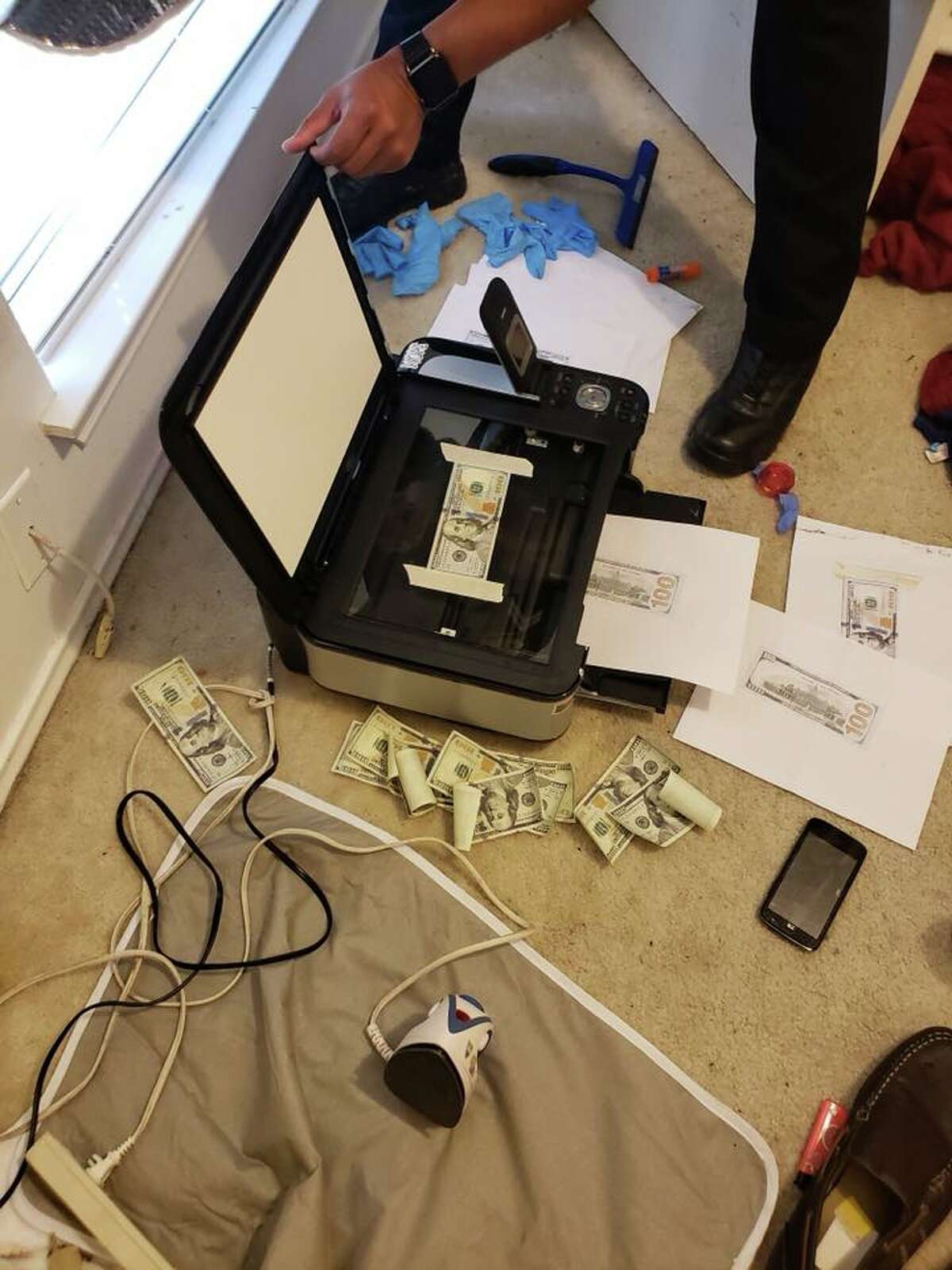 San Antonio police seized $1,000 in counterfeit cash and narcotics from a Northeast Side home on July 9, 2018.