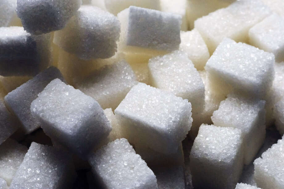 FILE - Piles of refined white sugar cubes sit at a Ukraine factory in 2017. Photo: Bloomberg Photo By Vincent Mundy. / Bloomberg