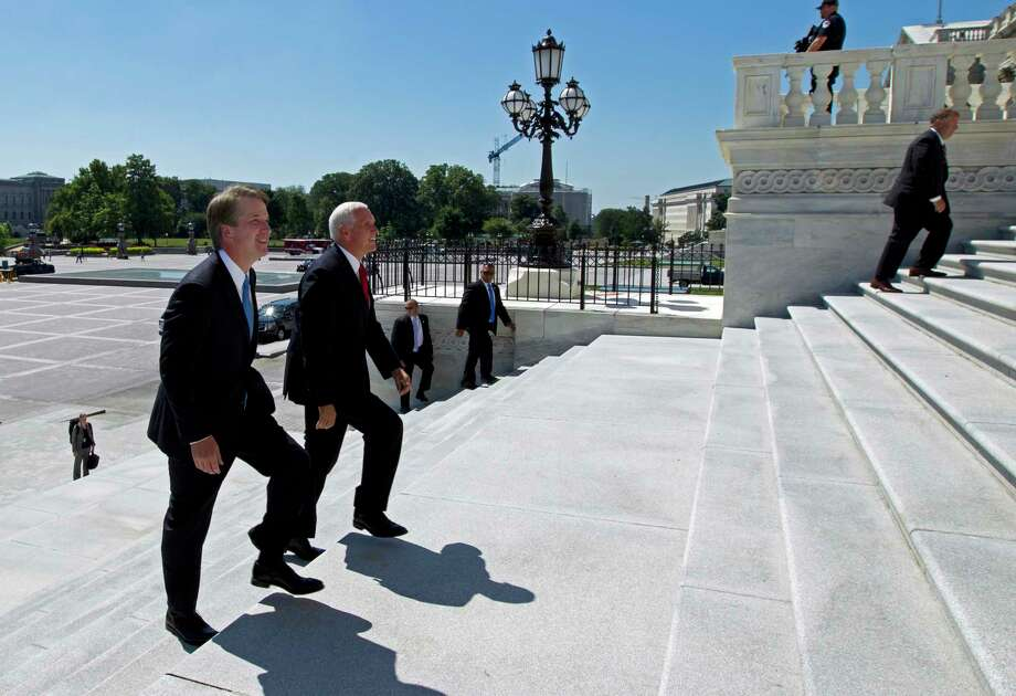 Vice President Mike Pence, right, accompanied by Supreme Court nominee Judge Brett Kavanaugh, arrives at the U.S. Capitol in Washington on Tuesday, July 10, 2018.If confirmed by the Senate, Kavanaugh is expected to shift ideology on the nation's highest court. Photo: Jose Luis Magana, AP / Copyright 2018 The Associated Press. All rights reserved