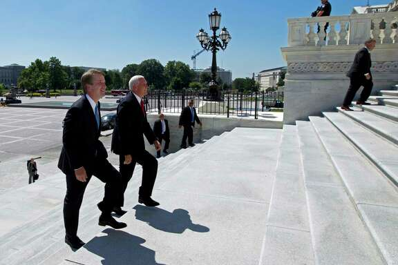 Vice President Mike Pence, right, accompanied by Supreme Court nominee Judge Brett Kavanaugh, arrives at the U.S. Capitol in Washington on Tuesday, July 10, 2018.