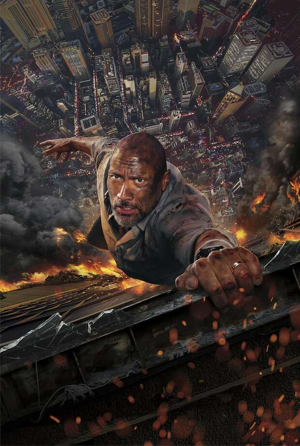 """Dwayne Johnson plays a former FBI agent who is in Hong Kong for a safety check on a building that becomes an inferno in """"Skyscraper,"""" not one of his better films. Photo: Universal Pictures"""