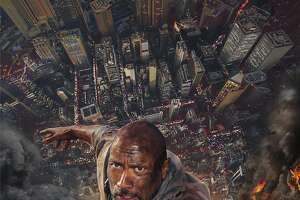 """This image released by Universal Pictures shows Dwayne Johnson in a scene from """"Skyscraper."""" (Universal Pictures via AP)"""