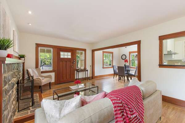 The living room features recessed lighting and hardwood moldings.�