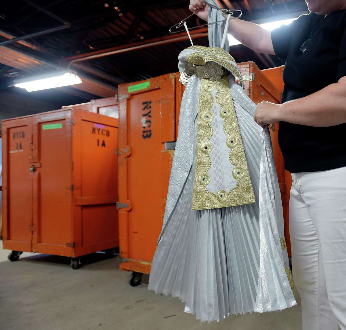 Marquerite Mehler, director of production for the New York City Ballet, shows one of the hundreds of ballet costumes that dancers will wear during the New York City Ballet Saratoga season at Saratoga Performing Arts Center on Tuesday, July 10, 2018, in Saratoga Springs, N.Y. (Paul Buckowski/Times Union)