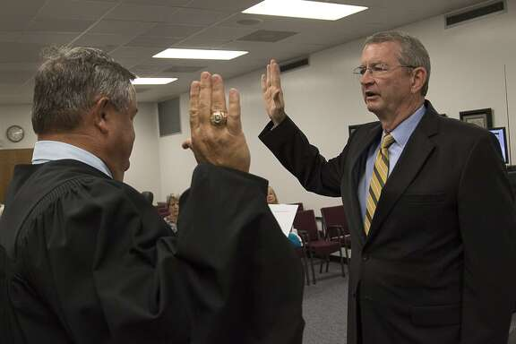 Wharton County Junior College trustee J. Paul Pope of El Campo, right, is officially sworn in by District Judge Randy Clapp. Pope was sworn in at the June 19 board of trustees meeting and will serve a six-year term.