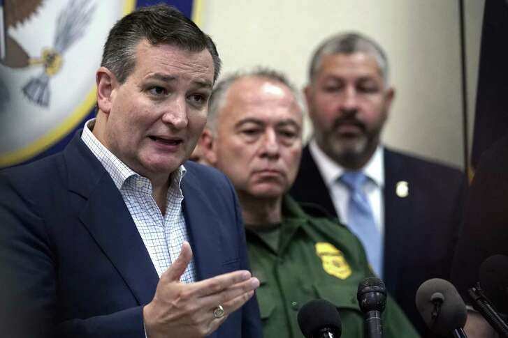 In this June 22, 2018, file photo, Sen. Ted Cruz, R-Texas, left, answer a question during a news conference after participating in a roundtable discussion on immigration in Weslaco, Texas.