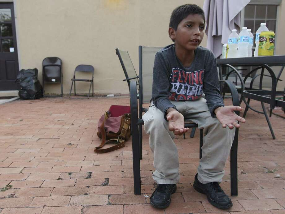 Salvadoran immigrant Jhonatan Bolanos, 10, talks about how he and his brother were separated from their mother, Esmeralda, after being detained by Border Patrol. Photo: Kin Man Hui /San Antonio Express-News / ©2014 San Antonio Express-News