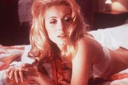 "Catherine Deneuve stars in the 1968 Luis Bunuel film ""Belle de Jour."""