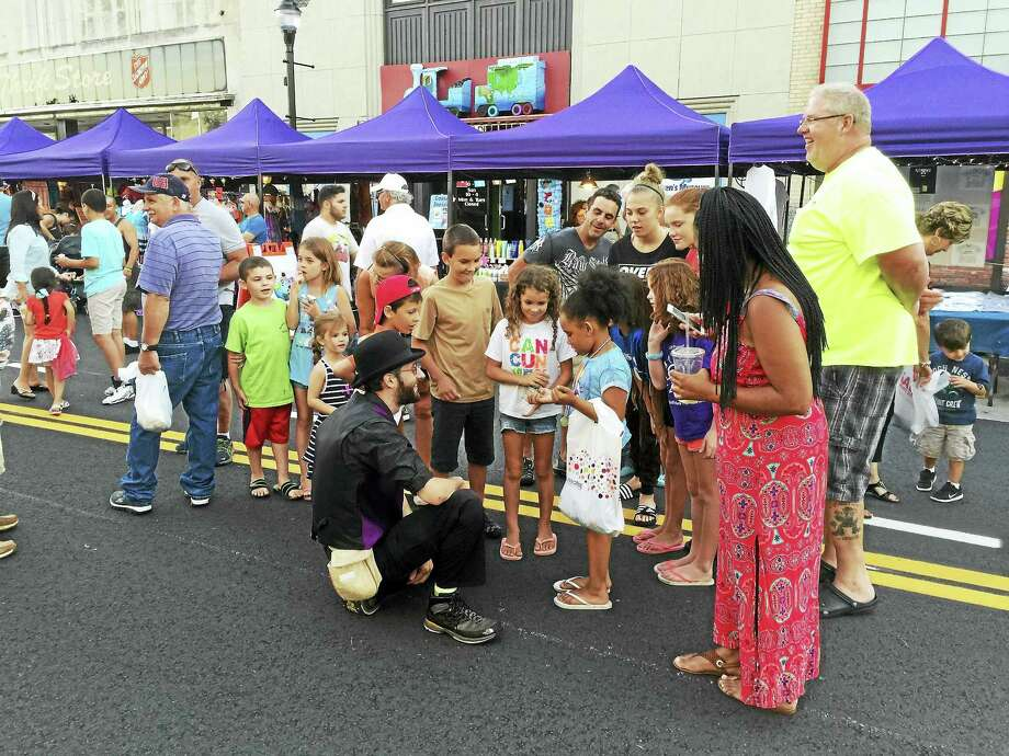 Street performers entertain children during a previous Main Street Marketplace in Torrington Photo: File Photo