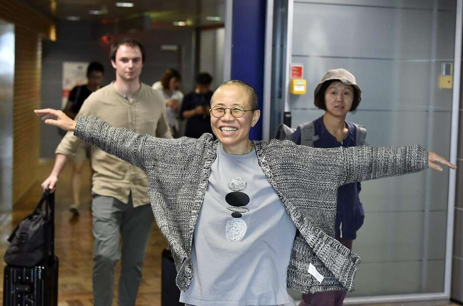 TOPSHOT - Liu Xia, the widow of Chinese Nobel dissident Liu Xiaobo, smiles as she arrives at the Helsinki International Airport in Vantaa, Finland, on July 10, 2018.  Despite facing no charges, the 57-year-old poet had endured heavy restrictions on her movements since 2010 when her husband won the Nobel Peace Prize -- an award that infuriated Beijing. / AFP PHOTO / Lehtikuva / Jussi Nukari / Finland OUTJUSSI NUKARI/AFP/Getty Images Photo: JUSSI NUKARI, AFP/Getty Images
