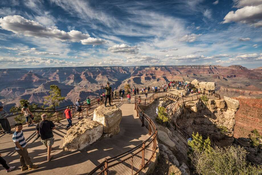 Tourists catch the gorgeous views of the Grand Canyon at Mather Point on the South Rim. Last week, a man plunged to his death after climbing over a railing near here. Photo: Miroslav_1/Getty Images / miroslav_1