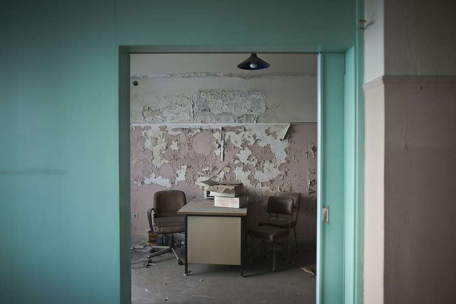 An office inside a 7-story building near central Athens' gritty Omonia Square has been empty since a now-defunct farm cooperative fund left years ago. Photo: Petros Giannakouris / Associated Press