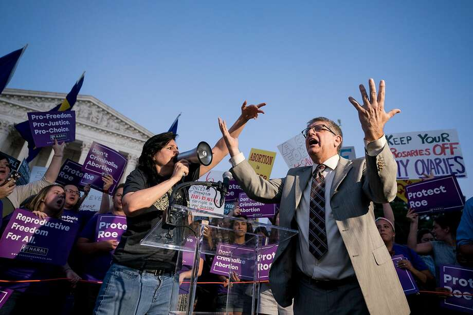 A man protesting abortion rights yells at a group of pro-choice demonstrators outside the Supreme Court before President Donald Trump announced his nominee to the Supreme Court, in Washington, July 9, 2018. With the country polarized and the Supreme Court's ideological balance at stake, the battle over Brett Kavanaugh will most likely cost tens of millions of dollars. (Erin Schaff/The New York Times) Photo: ERIN SCHAFF, NYT