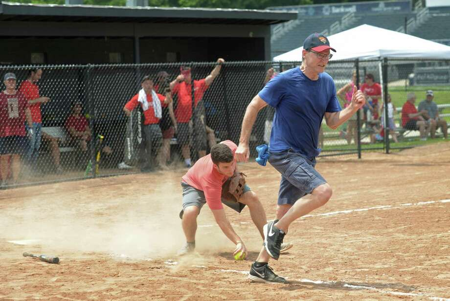 Republican catcher Luke Terradista handles a bunt by Democrat Bob Sabo during the annual Wilton Frivolity Bowl Wednesday, July 4, 2018, where town Republicans and Democrats face off during a friendly game of softball at Wilton High School in Wilton, Conn. Photo: Erik Trautmann / Hearst Connecticut Media / Norwalk Hour
