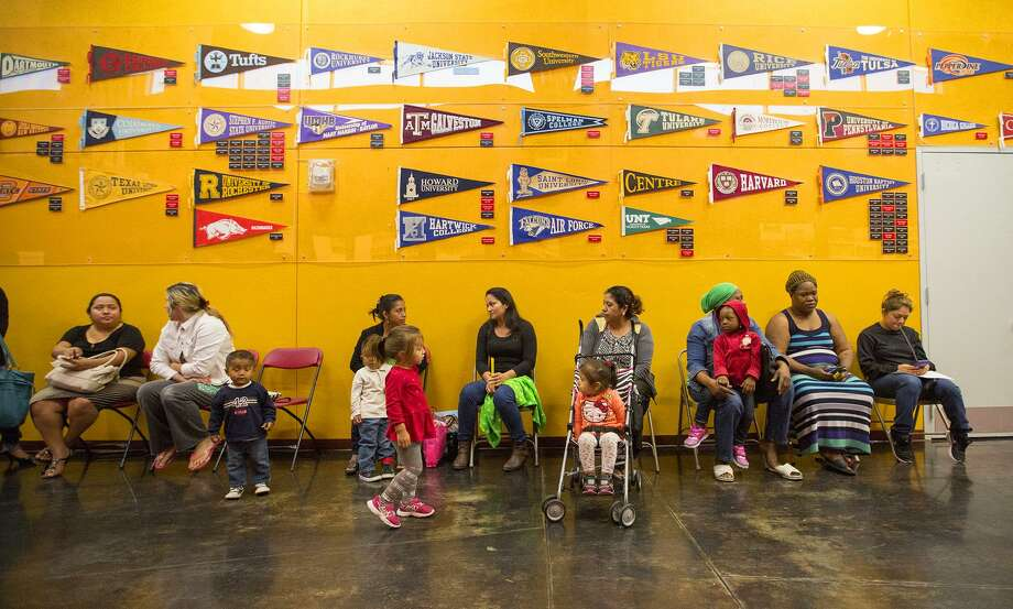 In this 2015 file photo, parents wait to sign up for the KIPP charter school system lottery in Houston. (Cody Duty / Houston Chronicle) Photo: Cody Duty,  Staff / Houston Chronicle / © 2015 Houston Chronicle