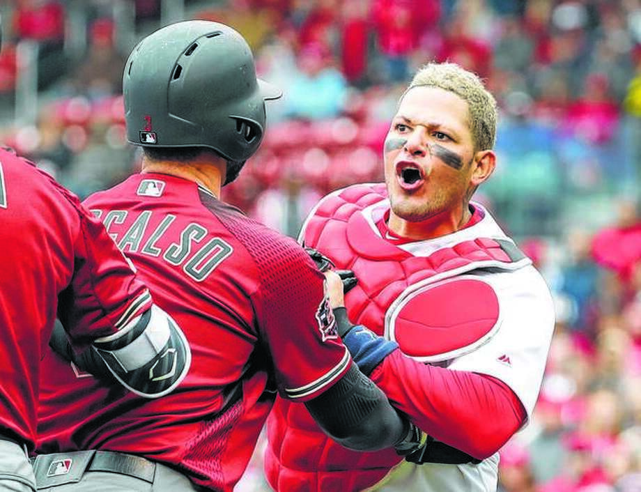 Cardinals catcher Yadier Molina, right, has been named to the National League All-Star team, replacing the Giants' Buster Posey, who will miss the game because of hip surgery. It is Molina's ninth All-Star Game selection. He is shown in action ealrier this season during an altercation with Arizona Diamondbacks manager Torey Lovullo (not pictured). Photo:     AP