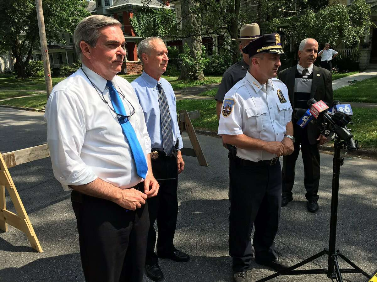 Schenectady Mayor Gary McCarthy, left, listens as Schenectady Police Chief Eric Clifford talks to the press about a shooting that injured five people on July 10, 2018.