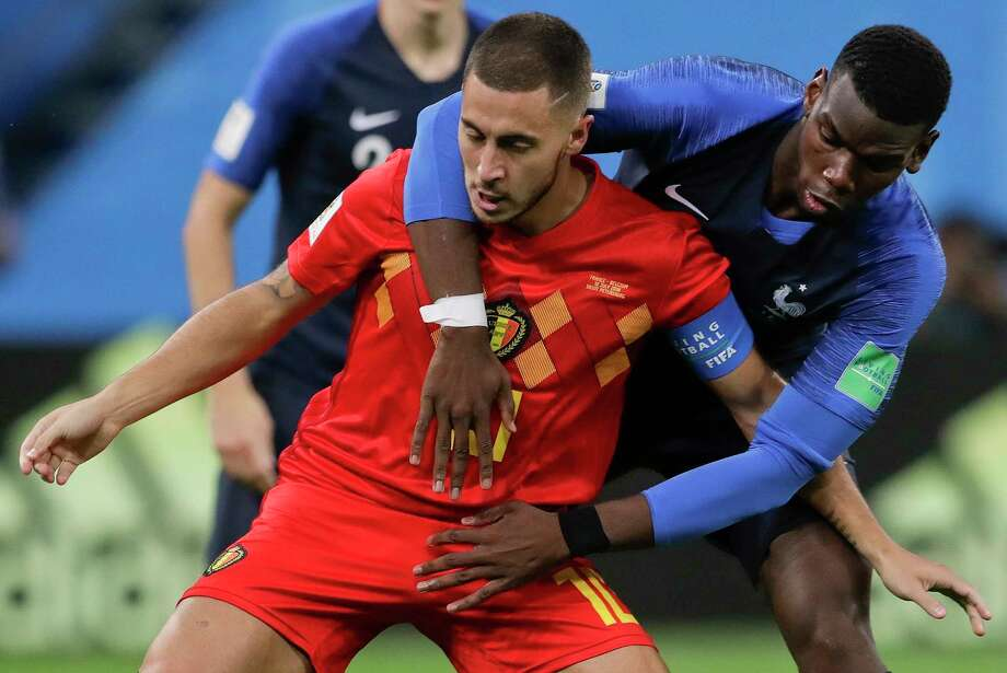 Belgium's Eden Hazard, left, is challenged by France's Paul Pogba during the semifinal match between France and Belgium at the 2018 soccer World Cup in the St. Petersburg Stadium, in St. Petersburg, Russia, Tuesday, July 10, 2018. Photo: Petr David Josek, AP / Copyright 2018 The Associated Press. All rights reserved